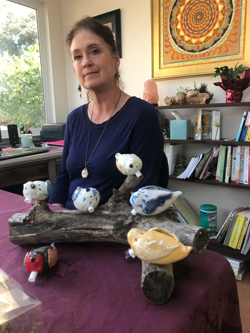 Local artist Janice Hofmann is making 86 ceramic birds, one for each life lost in the Camp Fire. Rolled up in the heart opening of each bird, she will place a victim's published Enterprise-Record obituary. (Robin Epley -- Enterprise-Record)