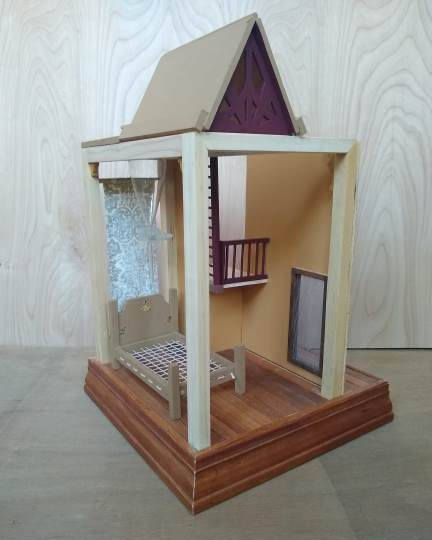 "Mariam Pakbaz,			""The Permeable Chamber"", mixed media, $250. This miniature space is ready to accept its tiny occupant. The Permeable Chamber is set up for noninvasive sleep experiments and maximum dream access."
