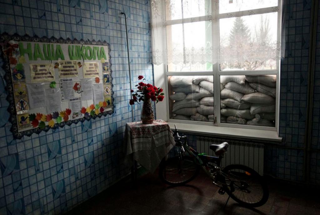 "Anastasia Vlasova, ""A view of a school window blocked with sandbags to protect from shelling in Verkhnyotoretske, Donetske, Ukraine"", 2016, photo"
