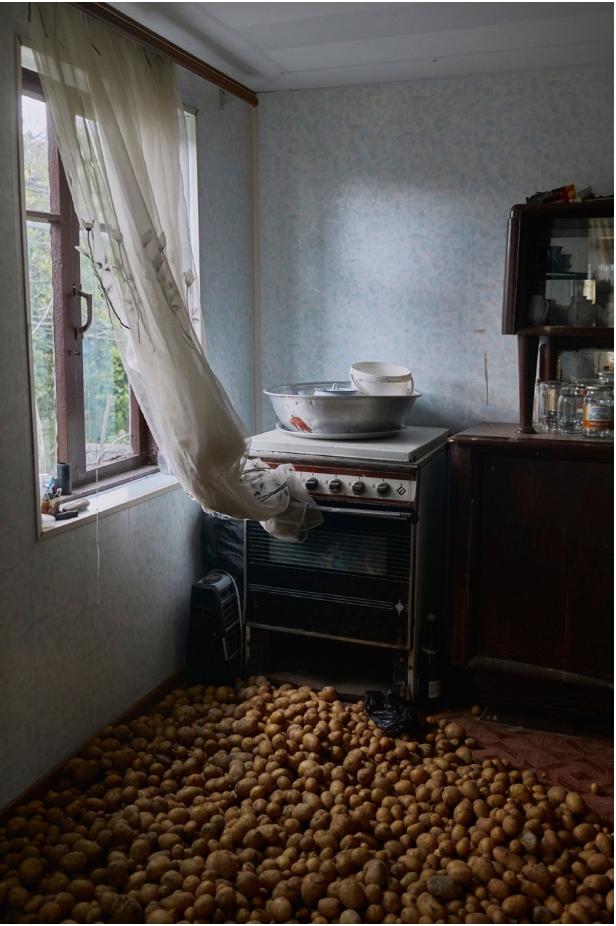 "Ksenia Kuleshova, ""Potatoes are stored on the floor in order for them to stay dry in Eshera Abkhasia, 2017, photo"