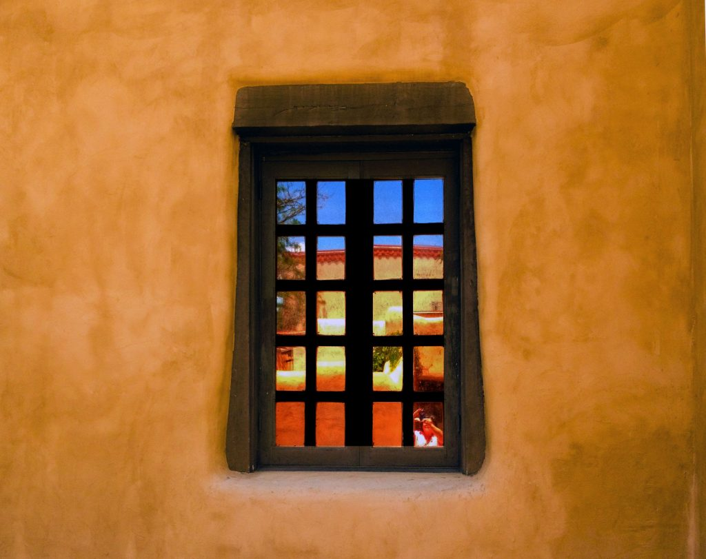 "Cris Guenter (Chico,	CA), ""Beyond"", photography, NFS.   Windows… Sometimes you are outside looking in and sometimes you are inside looking out. Either way there is always wonder at what is beyond that pane of glass. And that wonder can lead to some self-reflection. Currently, I am grateful for being able to get lost the lines, colors, and shapes that inspire me to make and share art."