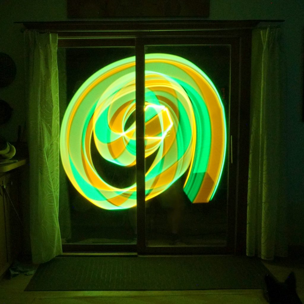 "Patrick Collentine & Susan Larsen, (Chico, CA),	""Aromatic Leap"", digital photograph, 10 x 10"",  $200.	 A mystical window swirl betrayed by the light"""
