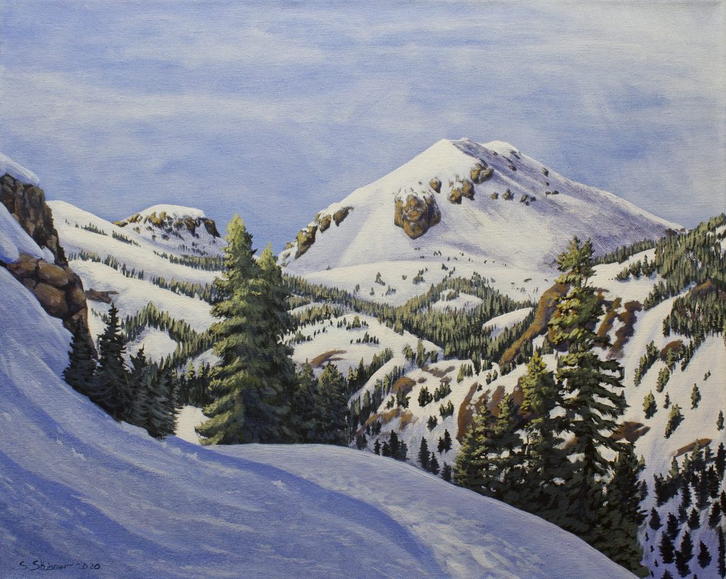 "Sarah Skinner	(Durham, CA),	""Winter in Lassen"", acrylic on canvas, 16"" x 20"", $250.  My greatest joy is found in the wild mountains. Lassen Volcanic National Park is one of my favorite spots to visit. In the winter, the park is all but deserted, the perfect place for winter solitude. I had purchased a pair of snowshoes as part of my goal to get in shape and get more active and took a few trips up to the Kohm-Yah-Ma-Nee visitor's center this winter. Little did I know that my last trip in early February would be my last. The world caught on fire, we were locked down, and the park closed for our safety and the safety of those who work there. If I cannot visit, I can at least paint it. I chose to paint the view I witnessed at the turnaround point of my last snowshoe expedition, 2 1-2 miles up the snow-covered park road at the first good vista of Lassen Peak as you come around the eastern flank of Diamond Peak. Tracks in the snow showed that few people came that far. It was a hard hike and one that I am still proud of. The only sounds were the wind and the chickadees. I had been thinking of painting this scene for some time and now seemed like the perfect time, a way to escape the endless cycles of boredom and anxiety that mark this trying time. I'll get back up there when the virus is under control, but for now, painting will do."