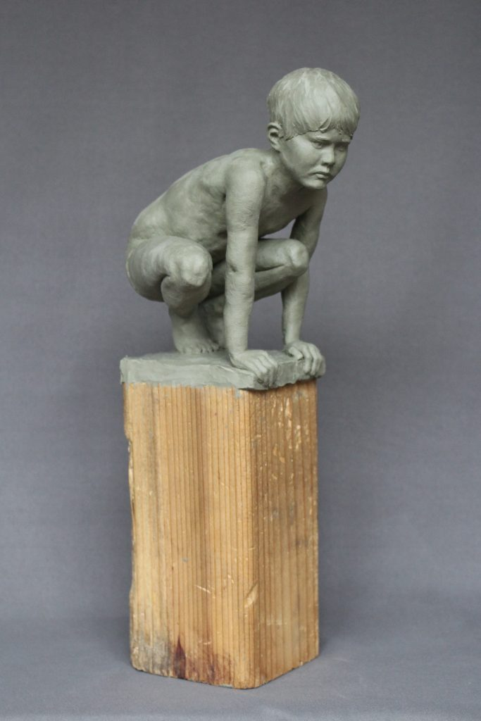 "Nicholas	Thompson (Ottawa, Canada), Crouching Boy, clay (for Bronze), 6x4.5x7"", $1200. I have two young children, so living in lockdown for me has been dominated by parenting. I have found it tremendously challenging to find balance and remain emotionally centered while trying to manage kids all day every day. Once the schools closed I asked my son to pose for me for a sculpture. I hope it reflects our shared feeling of quietly waiting for things to change."