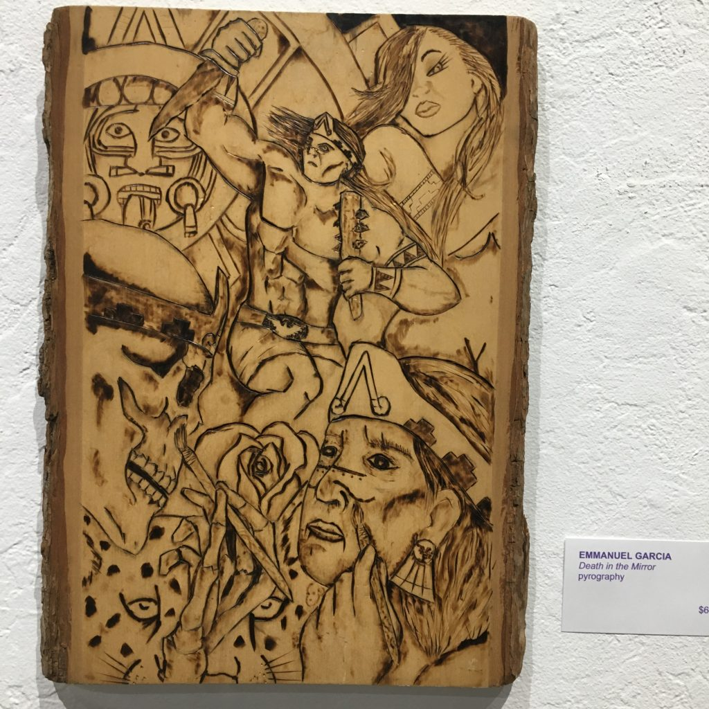 "EMMANUEL GARCIA, ""Death in the Mirror"", pyrography, $60."