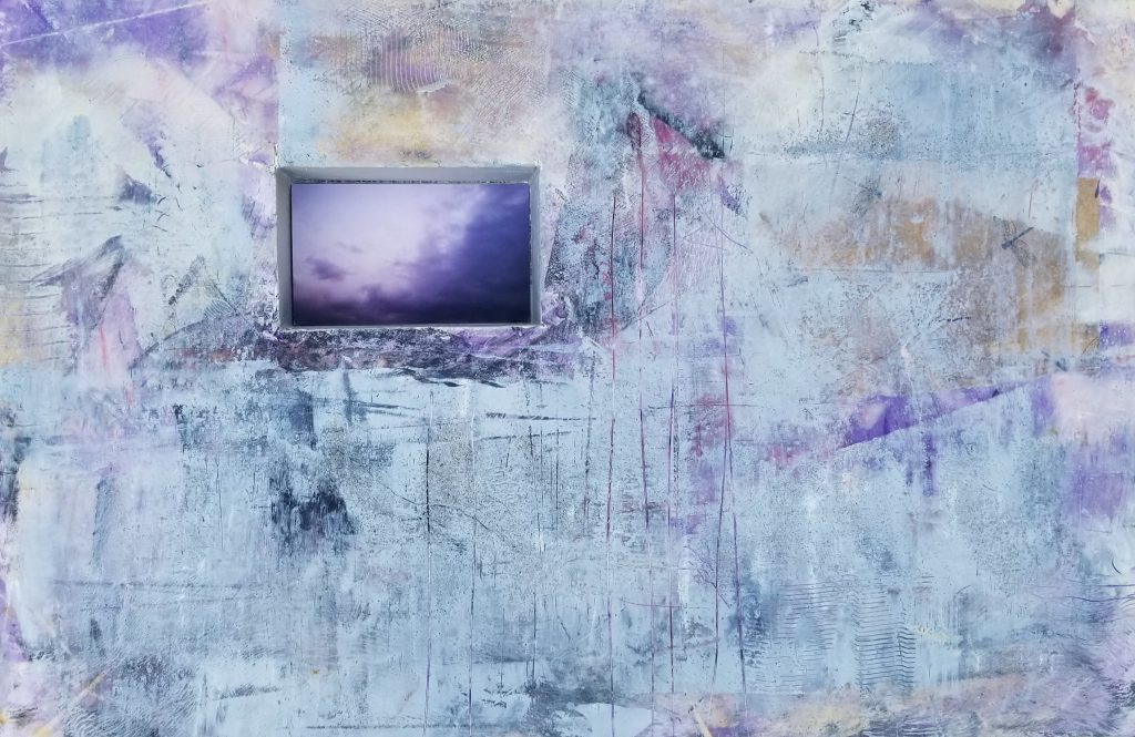 "Lori Stevens, Untitled, Cold Wax and Photography, 24 x 16 x 2.5"", $300. During these days of pandemic, I found solace in moving colors and textures into emotive surfaces around a window of clouds, signifying the beauty what we all still have access to and of life in general."