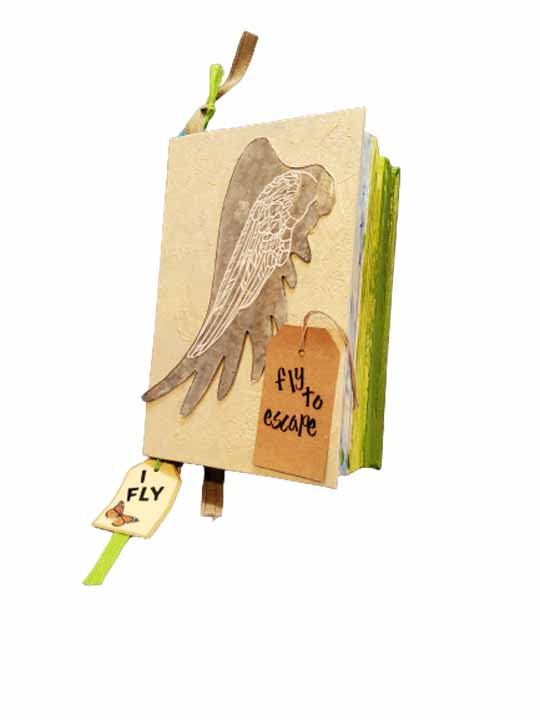 Erin Wells, Flight, 2020-21, Mixed media, 9 x 5.25 x 2.5 inches, $150.  I have always dreamed of flying. I actually did fly as a young woman and my love affair with flight continues on today. I love to watch all flyers, be they human, mechanical, animals or insects. The gift of flight is a wonderful act to behold.