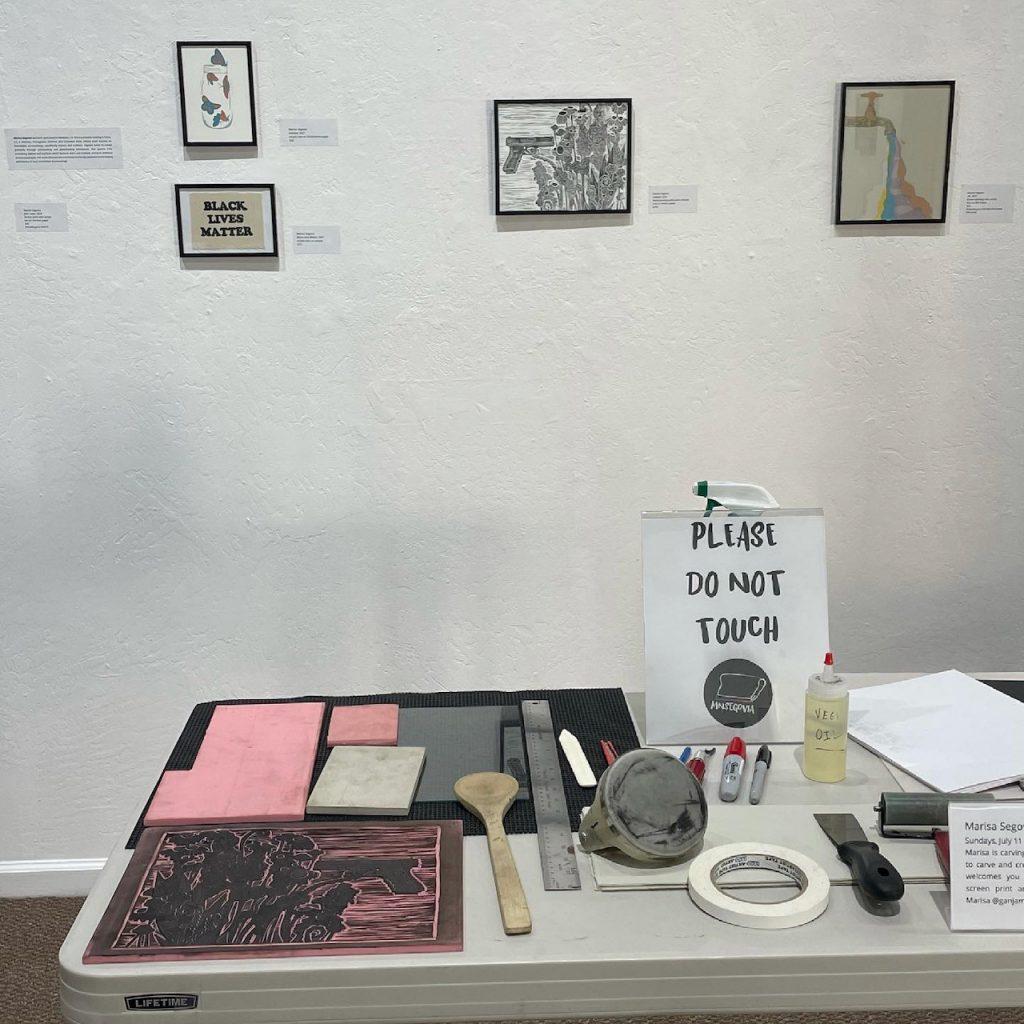 Marisa Segovia's work table with linocut materials