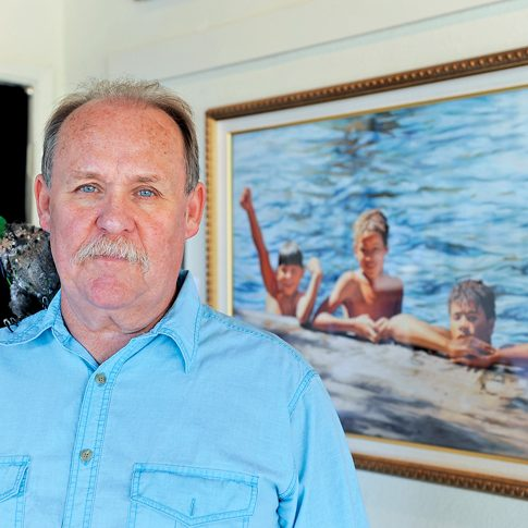 Chris Kaufman/Appeal-Democrat Waif Mullin, of Chico, with his bird Pappi, will have a show of his pastel work at The Theater Gallery on Plumas Street in Yuba City.